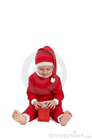 Little kid in santa costume with present