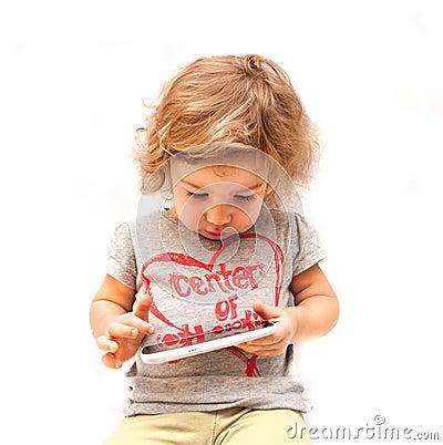 Little kid swiping white smartphone