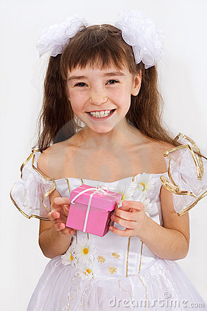 Little laughing girl holding christmas present