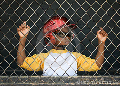 Little League Baseball Player in the Dugout 3