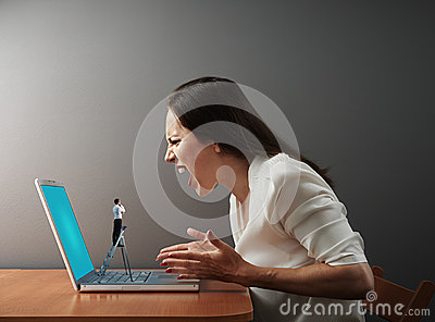 Little man from technical support looking at woman