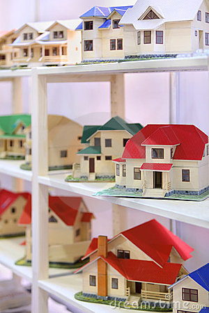 Little models of cottages stand on shelves