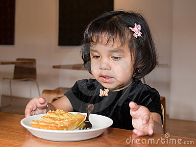Little Native American girl eating quiche