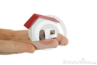 Little paper model of village house on hand