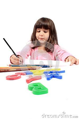 Little preschooler drawing or writing
