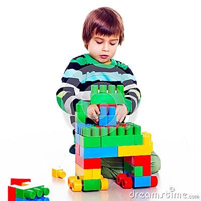 Free Little Pretty Boy Playing Lego Stock Photo - 77930020