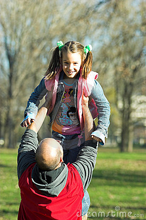 Little pretty child happy running to father