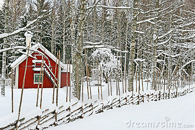 Little red house covered by snow