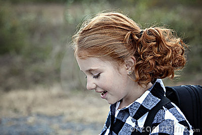 Little redhead with pigtails