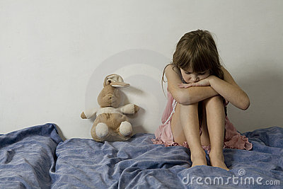 Little sad young girl with hare