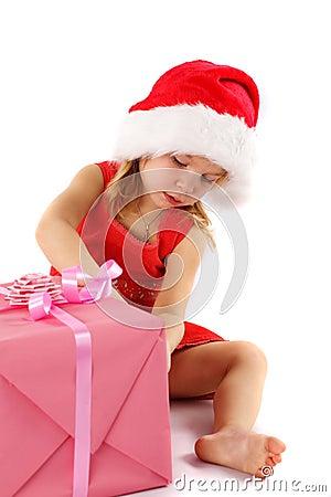 Little Santa girl with gift