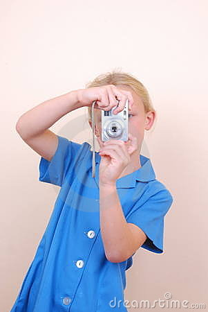 Little school girl taking pictures