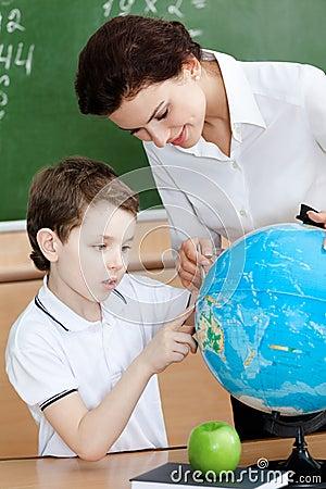 Little schoolboy studies geography