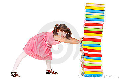 Little schoolgirl push a stack of heavy books