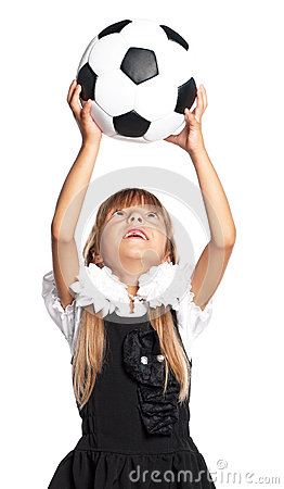Little schoolgirl with soccer ball