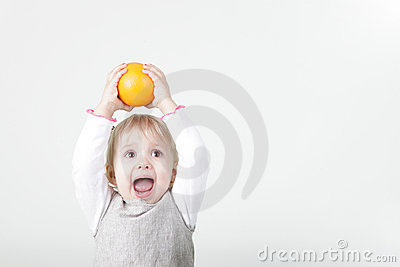 Little screaming girl with orange