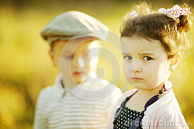 Little serious girl and boy