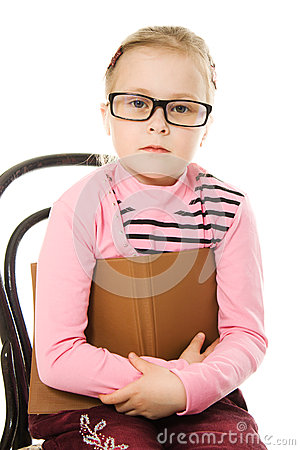 The little serious girl in glasses with a book