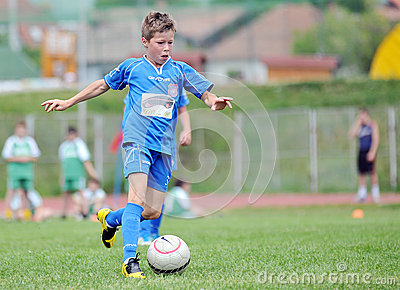 Little single child plays football or soccer Editorial Stock Image