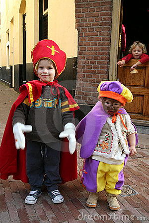 Little Sinterklaas and Zwarte Piet Editorial Stock Image