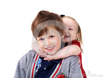 Little sister hugging her brother