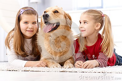 Little sisters and dog at home