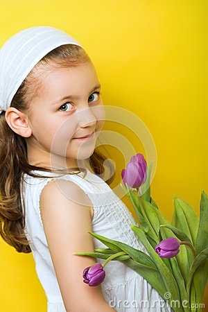 Little smiling girl with flowers