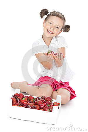 Little smiling girl holdind fruit on white