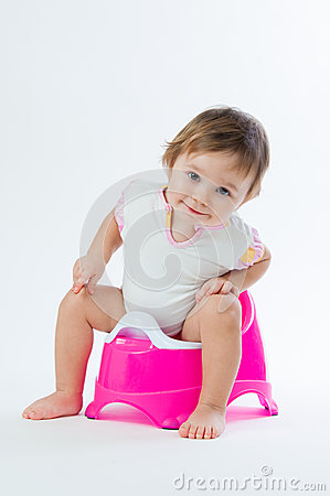 Free Little Smiling Girl Sitting On A Pot.  On White Background. Royalty Free Stock Photos - 88257858