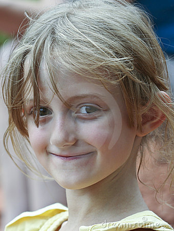 A Little Smiling Girl with Wispy Hair