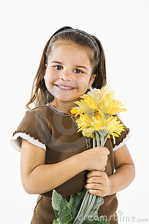 Little smiling hispanic girl with flowers.