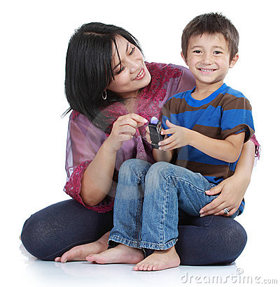 Little son with his pretty  mother