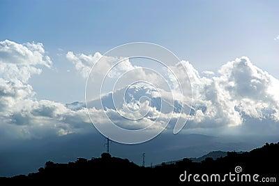 The little streak of white is Mount Etna, in fact