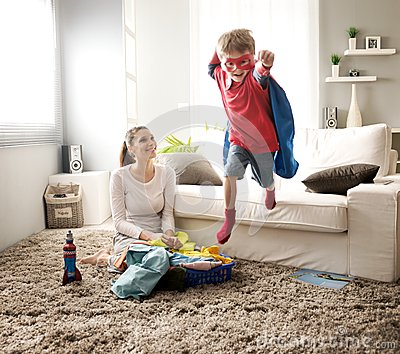 Little Superhero Helping His Mother Stock Photo Image