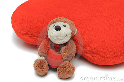 Little teddy-bear holding red heart