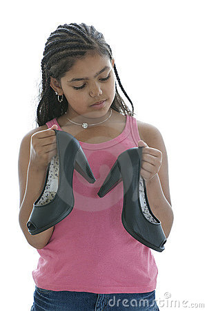 Little Teenage Girl Is Looking At High Heels Shoe