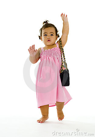 Little thai-english girl walking with purse