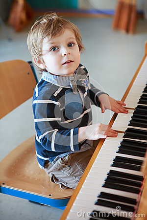 Free Little Toddler Boy Playing Piano At Music School. Stock Image - 35350781