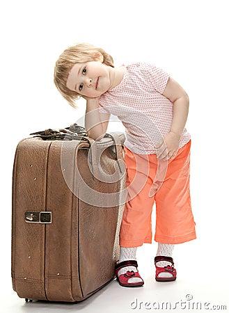 Little traveler preparing for a trip