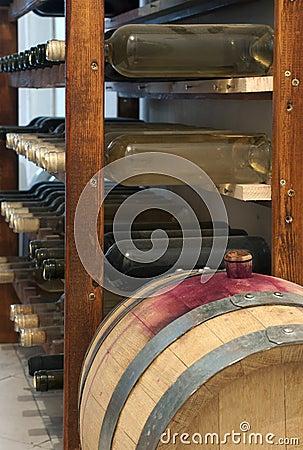 A little wine barrel and bottles wine
