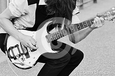 Live music by teenageron electric guitar Editorial Image
