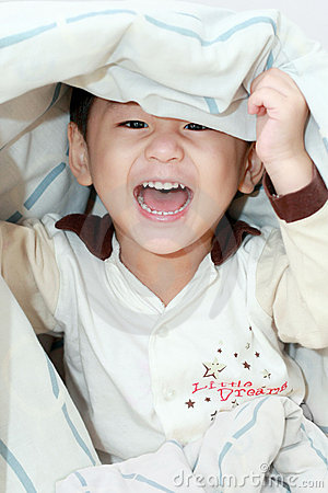Lively asian boy laughing