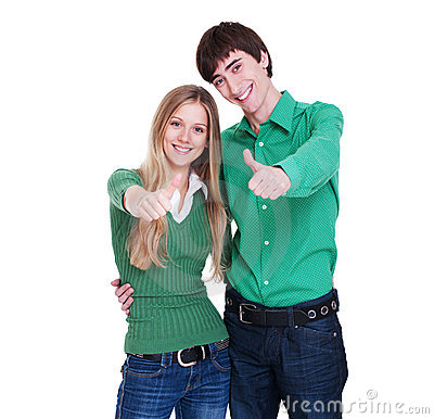 Lively couple showing thumbs up