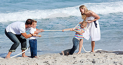 Lively family playing tug of war