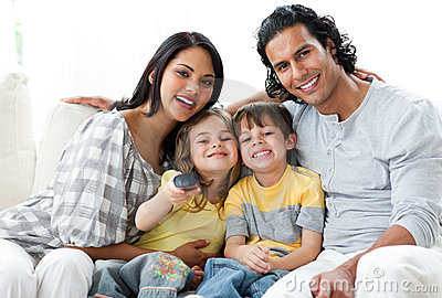 Lively family watching TV  together