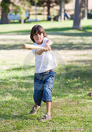 Lively little boy playing baseball Stock Photo
