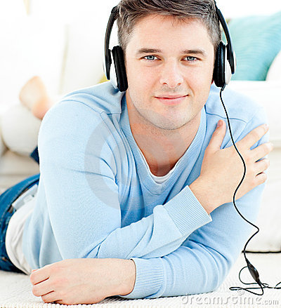 Lively young man listen to music with headphones