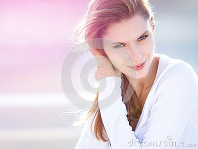 Lively young woman touches her hair