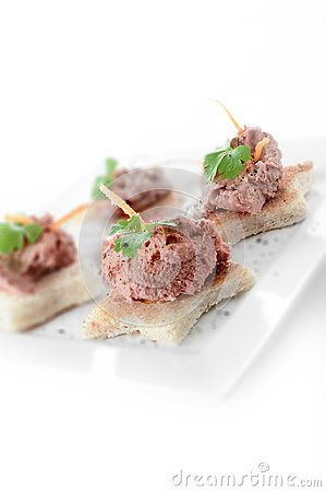 Liver pate canapes stock photo image 48005860 for Canape garnishes
