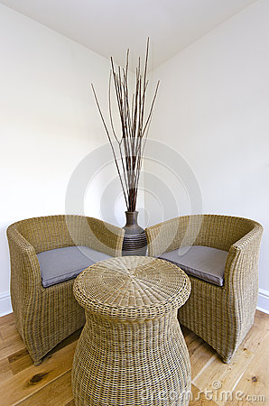 Living room detail with a rattan chairs and table